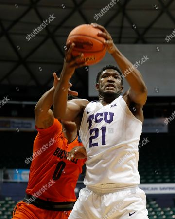 TCU center Kevin Samuel (21) grabs a rebound away from Bucknell center Paul Newman (0) during the second half of an NCAA college basketball game at the Diamond Head Classic, in Honolulu