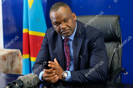 Corneille Nangaa, president of the independent electoral commission (CENI), speaks to reporters, in Kinshasa, Democratic Republic of the Congo. Presidential elections scheduled for Dec. 23 was postposed to Sunday, Dec. 30