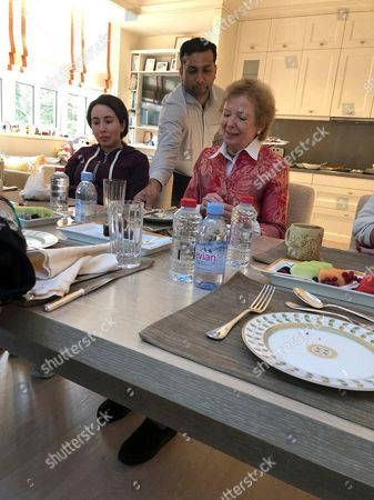 Latifa bint Mohammed Al Maktoum, Mary Robinson. In this Dec. 15, 2018 photo, released, by the United Arab Emirates' Ministry of Foreign Affairs and International Cooperation, Sheikha Latifa bint Mohammed Al Maktoum, a daughter of Dubai's ruler Sheikh Mohammed bin Rashid Al Maktoum, left, eats a meal with Mary Robinson, a former United Nations High Commissioner for Human Rights and former president of Ireland, right, in Dubai, United Arab Emirates. The UAE released the first images of Sheikha Latifa on Monday, months after friends and supporters say she disappeared following commandos storming a boat carrying her off the coast of India after she fled the Emirates