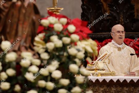 Cardinal Tarcisio Bertone attends the Christmas Eve Mass celebrated by Pope Francis in St. Peter's Basilica at the Vatican