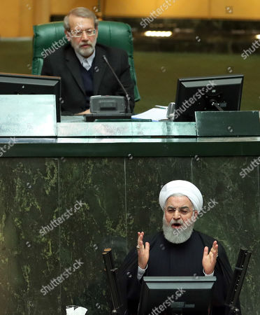 Stock Image of Iranian President Hassan Rouhani (bottom) delivers his speech to present the Iranian New Year budget as parliament speaker Ali Larijani (top) listens during the parliament session in Tehran, Iran, 25 December 2018. According to reports, Rouhani said in his speech that US, by forcing sanctions against the country, hits the lives, development and economic growth. Rouhani presented the budget draft at about 4,700 trillion Iranian Rials for the next Iranian year which starts on 21 March 2019.
