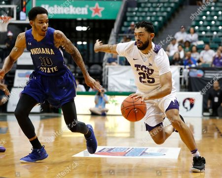 Indiana State guard Christian Williams (10) defends against TCU guard Alex Robinson (25) during the first half of an NCAA college basketball game at the Diamond Head Classic, in Honolulu