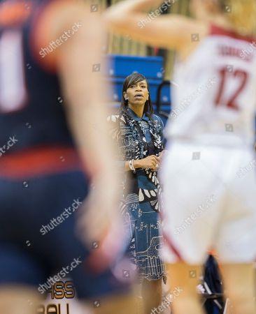 Virginia Cavaliers head coach Tina Thompson looks on during an NCAA college basketball game against the Alabama Crimson Tide, in Winter Park, Fla