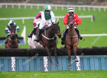 Limerick BUCKIE CULLEN & Jonathan Moore (right) jump the last to win the Guinness Maiden Hurdle from COILLTE EILE & Ambrose McCurtin (left)
