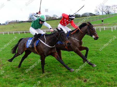 Limerick BUCKIE CULLEN & Jonathan Moore (right) win the Guinness Maiden Hurdle from COILLTE EILE & Ambrose McCurtin (left)