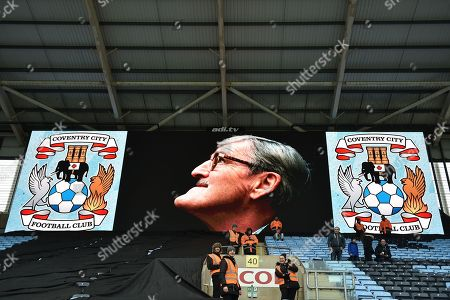 Jimmy Hill OBE on the big screen flanked by Coventry City club crests during the EFL Sky Bet League 1 match between Coventry City and Charlton Athletic at the Ricoh Arena, Coventry
