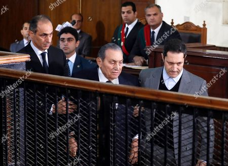 Former Egyptian President Hosni Mubarak (C) accompanied by his two sons Gamal (L) and Alaa (R) arrive at courthouse as Mubarak will testify in case related to a 2011 prison break, in Cairo, Egypt, 26 December 2018. According to reports, Mubarak appeared in a courthouse to testify in the retrial related to prison break in 2011 in which ousted president Mohamed Morsi and others are facing charges. Morsi, along with other senior members of the now-banned Muslim Brotherhood group, has already been sentenced to death over the charges in the first trial.
