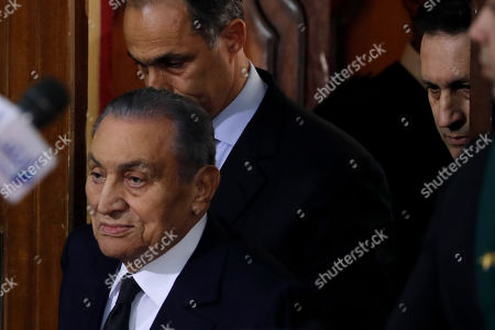 Former Egyptian President Hosni Mubarak (L) accompanied by his two sons Gamal (2-L) and Alaa (R) arrives at courthouse as Mubarak will testify in case related to a 2011 prison break, in Cairo, Egypt, 26 December 2018. According to reports, Mubarak appeared in a courthouse to testify in the retrial related to prison break in 2011 in which ousted president Mohamed Morsi and others are facing charges. Morsi, along with other senior members of the now-banned Muslim Brotherhood group, has already been sentenced to death over the charges in the first trial.