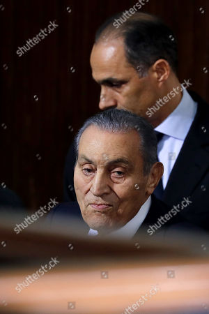 Former Egyptian President Hosni Mubarak (front) accompanied by his son Gamal arrives at courthouse as Mubarak will testify in case related to a 2011 prison break, in Cairo, Egypt, 26 December 2018. According to reports, Mubarak appeared in a courthouse to testify in the retrial related to prison break in 2011 in which ousted president Mohamed Morsi and others are facing charges. Morsi, along with other senior members of the now-banned Muslim Brotherhood group, has already been sentenced to death over the charges in the first trial.