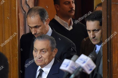Former Egyptian President Hosni Mubarak (C) accompanied by his two sons Gamal (L) and Alaa (R) arrives at courthouse as Mubarak will testify in case related to a 2011 prison break, in Cairo, Egypt, 26 December 2018. According to reports, Mubarak appeared in a courthouse to testify in the retrial related to prison break in 2011 in which ousted president Mohamed Morsi and others are facing charges. Morsi, along with other senior members of the now-banned Muslim Brotherhood group, has already been sentenced to death over the charges in the first trial.