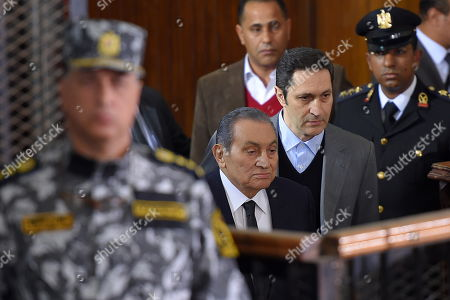 Former Egyptian President Hosni Mubarak (C-L) accompanied by his son and Alaa (C-R) arrives at courthouse as Mubarak will testify in case related to a 2011 prison break, in Cairo, Egypt, 26 December 2018. According to reports, Mubarak appeared in a courthouse to testify in the retrial related to prison break in 2011 in which ousted president Mohamed Morsi and others are facing charges. Morsi, along with other senior members of the now-banned Muslim Brotherhood group, has already been sentenced to death over the charges in the first trial.