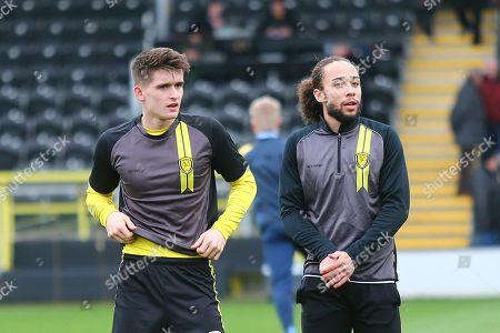 Burton Albion midfielder Marcus Harness (16) and Burton Albion midfielder Ben Fox (12) warm up during the EFL Sky Bet League 1 match between Burton Albion and Wycombe Wanderers at the Pirelli Stadium, Burton upon Trent
