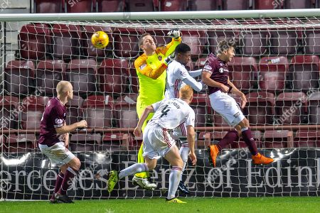 Goalkeeper Colin Doyle (#13) of Heart of Midlothian punches clear during the Ladbrokes Scottish Premiership match between Heart of Midlothian FC and Hamilton Academical FC at Tynecastle Stadium