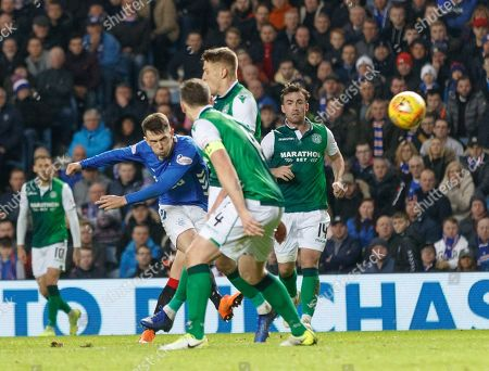 Stock Picture of Ryan Jack of Rangers shoots at goal through a crowd of Hibernian players. Hibernian goalkeeper Adam Bogdan (out of shot) tipped Jack's effort over the crossbar.