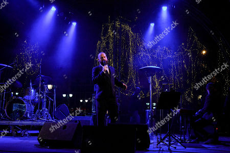 Stock Image of Alexandros Affolter seen performing at the Christmas concert tribute to Frank Sinatra on Syntagma Square in Athens.