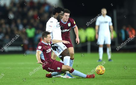 Wilfried Bony of Swansea City is tackled by James Chester of Aston Villa.