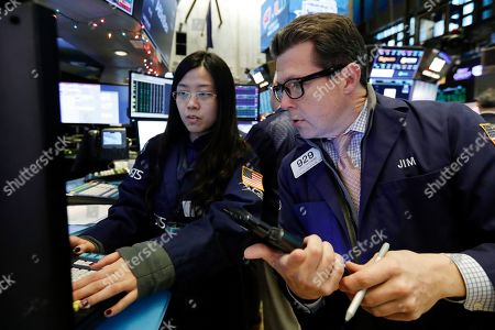 Vera Liu, James Matthews. Specialist Vera Liu, left, and trader James Matthews work on the floor of the New York Stock Exchange, . Stocks are opening strongly higher on Wall Street Wednesday, with real estate, raw materials and energy stocks leading a broad rebound from Monday's steep losses