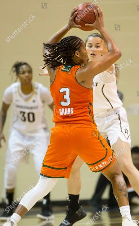 Stock Picture of Endia Banks, Jackie Welch. Miami (FL) Hurricanes guard Endia Banks (3) scans the court while defended by Vanderbilt Commodores guard Jackie Welch (4) during an NCAA college basketball game, in Winter Park, Fla
