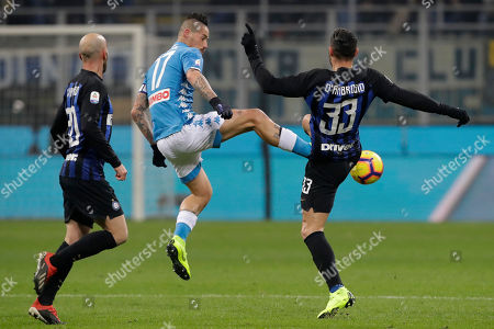 Napoli's Marek Hamsik, center, fights for the ball with Inter Milan's Danilo D'Ambrosio, right, and Inter Milan's Borja Valero during a Serie A soccer match between Inter Milan and Napoli, at the San Siro stadium in Milan, Italy