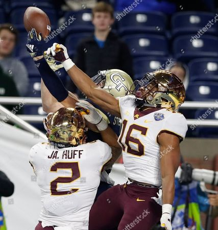 Jacob Huff, Coney Durr, Brad Stewart. Minnesota defensive backs Jacob Huff (2) and Coney Durr (16) break up a pass intended for Georgia Tech wide receiver Brad Stewart during the second half of the Quick Lane Bowl NCAA college football game, in Detroit