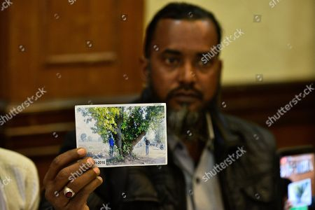 Afzal Ansari M, brother of Mazlum Ansari, shows a photograph during a press conference at Press Club of India, on December 26, 2018 in New Delhi, India. Mazlum Ansari, 32, and Imteyaz Khan, 13, were hanged from a tree after they were beaten up. A court in Jharkhand?s Latehar district on Wednesday held eight men guilty of thrashing two cattle herders to death in March 2016.