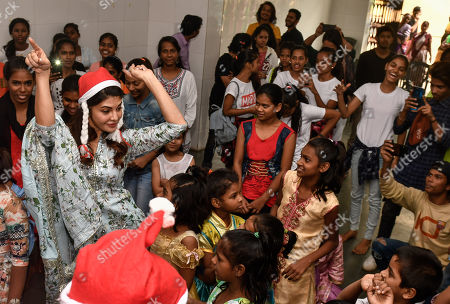 Stock Image of Jacqueline Fernandez poses for a selfie with kids as she celebrates Christmas with children of St. Catherine Orphange, Mount Mary Road