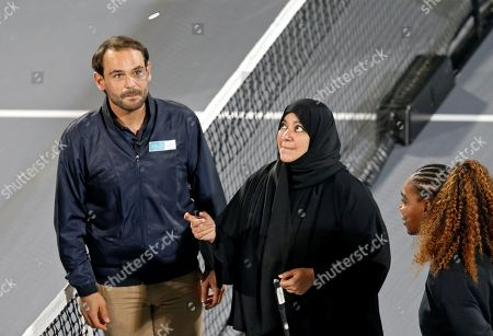 Fatima Bint Mubarak (C), widow of late Sheikh Zayed bin Sultan Al Nahyan, tosses the coin prior the match between Serena Williams (R) of the USA and Venus Williams (not pictured) of the USA at the Mubadala World Tennis Championship 2018 in Abu Dhabi, United Arab Emirates, 27 December 2018.