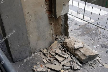 A view of a damaged column of the Vasari Corridor (Corridoio Vasariano), near Ponte Vecchio, in Florence, 27 December 2018. According to media reports, a truck that was delivering goods in the historic center of Florence reportedly bumped against a column of the Vasari Corridor early 27 December and severely damaging it. The piece of nineteenth century sandstone (pietra serena) was destroyed and the column along the Arno river was broken. The driver was later identified by traffic police using surveillance cameras. The director of the Uffizi Galleries, Eike Schmidt said that the damage created by the road accident was 'remarkable.'