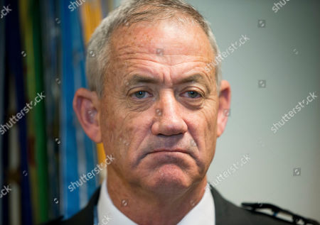 Israeli Defense Minister Benny Gantz pauses as he answers questions from members of the media during his meeting with Joint Chiefs Chairman Gen. Martin E. Dempsey, at the Pentagon. Gantz, former Israeli military chief, says he is running in the upcoming election