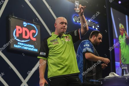 Michael van Gerwen wins his fourth round match against Adrian Lewis and acknowledges the crowd during the World Darts Championships 2018 at Alexandra Palace, London
