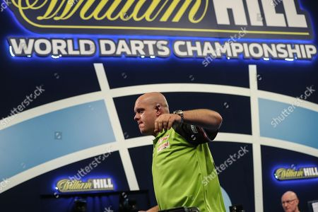 Michael van Gerwen wins his fourth round  match against Adrian Lewis and leaves the stage during the World Darts Championships 2018 at Alexandra Palace, London