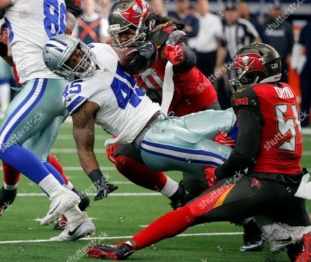 Stock Image of Rod Smith, Lavonte David, Jason Pierre-Paul. Dallas Cowboys running back Rod Smith (45) is stopped by Tampa Bay Buccaneers' Jason Pierre-Paul (90) and Lavonte David (54) during an NFL football game, in Arlington, Texas