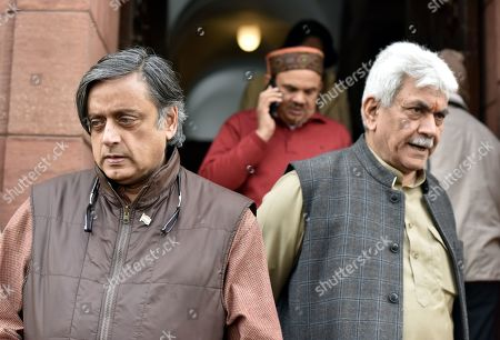 Congress MP Shashi Tharoor and Union Minister Manoj Sinha during the ongoing Winter Session of Parliament, on December 27, 2018 in New Delhi, India.