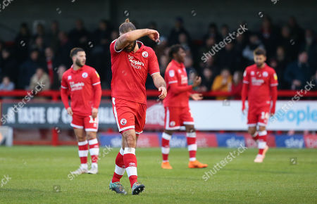 Joe McNerney of Crawley is sent off by referee Andy Daviesduring the EFL League Two match between  Crawley Town and Colchester United at the People's Pension Stadium in Crawley. 01 January 2019