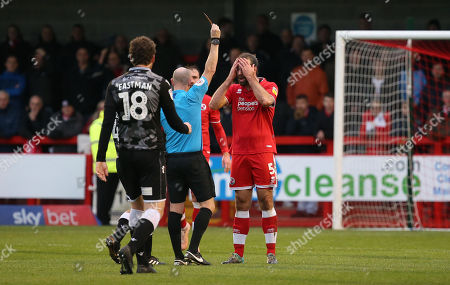 Referee Andy Davies shows Joe McNerney of Crawley a red card during the EFL League Two match between  Crawley Town and Colchester United at the People's Pension Stadium in Crawley. 01 January 2019