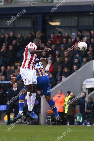 Saido Berahino (19) of Stoke City and Aaron Holloway (20) of Shrewsbury Town