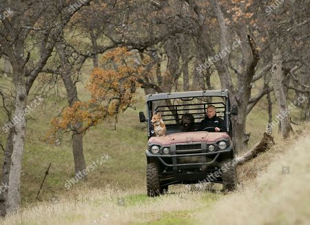 Gov. Jerry Brown tours his Colusa County ranch accompanied by his dogs, Colusa, left, and Cali, center, near Williams, Calif. Brown leaves office Jan. 7, 2019, after a record four terms in office, from 1975-1983 and again since 2011