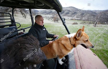 Gov. Jerry Brown tours his Colusa County ranch accompanied by his dogs Cali, left, and Colusa near Williams, Calif. Brown will retire to the ranch when he leaves office Jan. 7, 2019, after a record four terms in office, from 1975-1983 and again since 2011