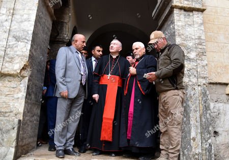 Vatican Secretary of State Cardinal Pietro Parolin (C) visits the al-Sa'ah church in the old city area, western Mosul, northern Iraq, 28 December 2018. The al-Sa'ah church was damaged by Islamic State militant when the town was under their control until it was liberated in June 2017.