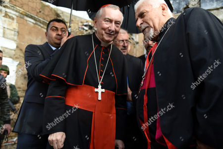 Vatican Secretary of State Cardinal Pietro Parolin (L) visits the al-Sa'ah church in the old city area, western Mosul, northern Iraq, 28 December 2018. The al-Sa'ah church was damaged by Islamic State militant when the town was under their control until it was liberated in June 2017.