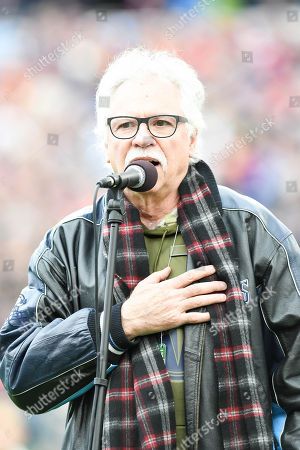 Oak Ridge Boys member Joe Bonsall sings the National Anthem during the game between the Purdue Boilermakers and the Auburn Tigers in the Franklin American Mortgage Music City Bowl at Nissan Stadium in Nashville. TN