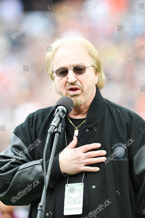 Oak Ridge Boys member Duane Allen sings the National Anthem during the game between the Purdue Boilermakers and the Auburn Tigers in the Franklin American Mortgage Music City Bowl at Nissan Stadium in Nashville. TN