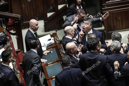 Emanuele Fiano (C-R) is asked to be quiet while PD and Lega deputies are on the verge of brawling during the examination of the budget law in the Lower House in Rome, Italy, 28 December 2018.