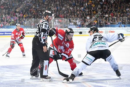 Team Canada's Cory Emmerton, left, and Ice Tigers's Daniel Weiss, right, fight for the puck during the game between Team Canada and Thomas Sabo Ice Tigers at the 92nd Spengler Cup ice hockey tournament in Davos, Switzerland, 28 December 2018.