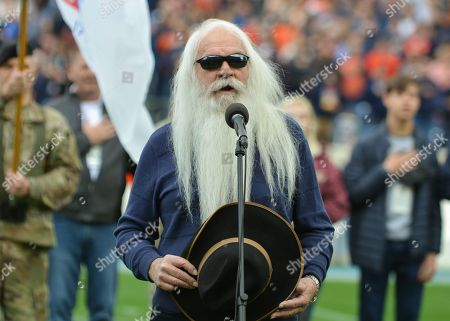 William Lee Golden of the Oak Ridge Boys sing the National Anthem before the Music City Bowl game between the Purdue Boilermakers and the Auburn Tigers at Nissan Stadium in Nashville, TN