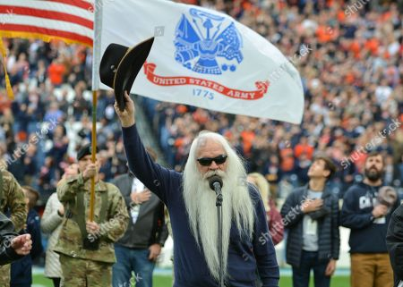 Stock Picture of William Lee Golden of the Oak Ridge Boys sing the National Anthem before the Music City Bowl game between the Purdue Boilermakers and the Auburn Tigers at Nissan Stadium in Nashville, TN