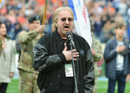 Duane Allen of the Oak Ridge Boys sings the National Anthem before the Music City Bowl game between the Purdue Boilermakers and the Auburn Tigers at Nissan Stadium in Nashville, TN