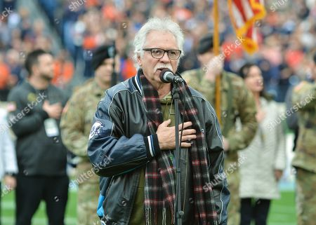 Joe Bonsall of the Oak Ridge Boys sings the National Anthem before the Music City Bowl game between the Purdue Boilermakers and the Auburn Tigers at Nissan Stadium in Nashville, TN