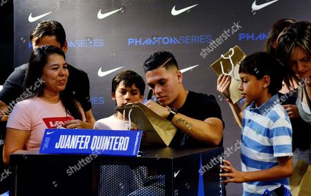 Colombian soccer player Juan Fernando Quintero (C) signs autographs during a press conference at a mall in Medellin, Colombia, 28 December 2018.