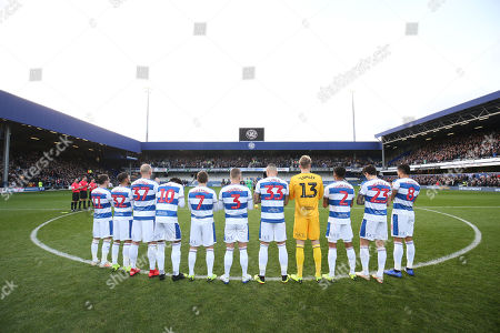 The teams take part in a minute's applause in memory of those QPR players (like Ray Wilkins) who died in 2018